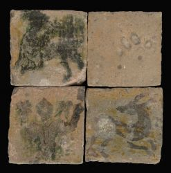 Four early painted floor tiles